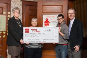 Robinson Donovan Presents Check to Homework House